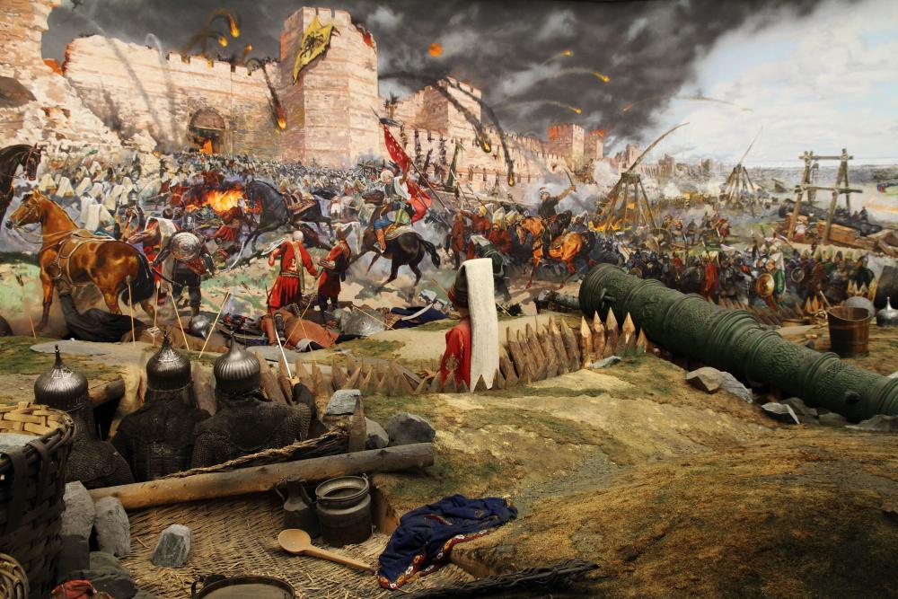 İstanbul'un fethi: Çift başlı kartallı Bizans sancağı düşerken surların arkasından yeni bir güneş doğuyor.
